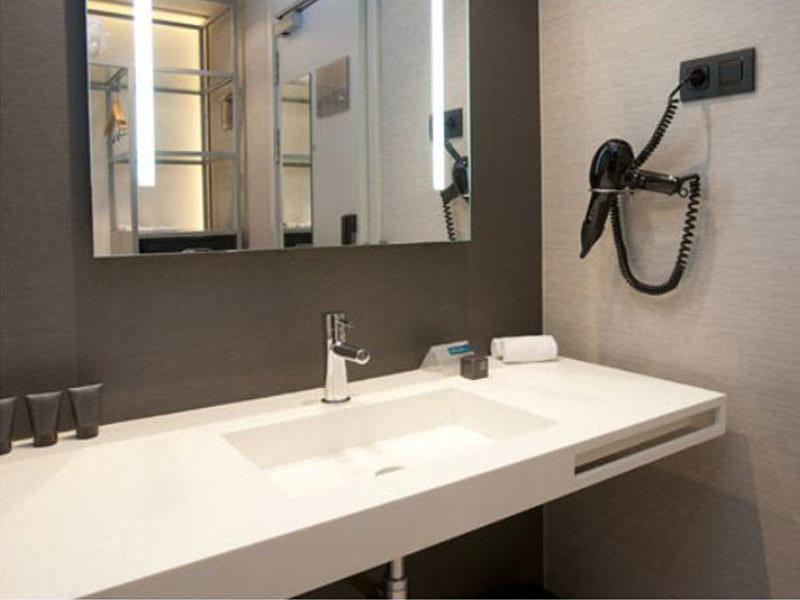 Solid surface bathroom vanities for AC hotel
